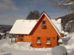 Holiday home Marianska II during the winter