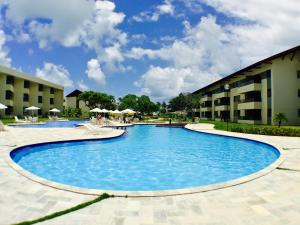 A piscina localizada em Carneiros Beach Resort ou nos arredores