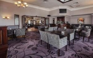 A restaurant or other place to eat at Midleton Park Hotel