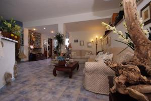 The lobby or reception area at Hôtel Sant'Andrea, The Originals Relais (Relais du Silence)