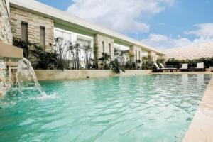 Бассейн в Hotel Estelar Yopal или поблизости