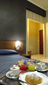 Letto o letti in una camera di Hotel Consul
