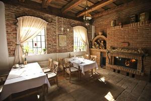 Reštaurácia alebo iné gastronomické zariadenie v ubytovaní Palenica Jelsovce