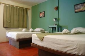 A bed or beds in a room at Hostal Chalupa