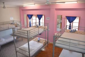 A bunk bed or bunk beds in a room at Caravella Central