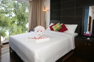 Un ou plusieurs lits dans un hébergement de l'établissement Ripple Beach Inn