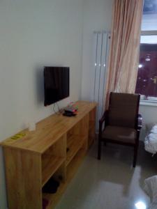Телевизор и/или развлекательный центр в Cherry Business Hotel
