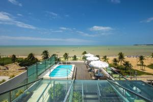 A view of the pool at Hotel Corais de Tambau or nearby