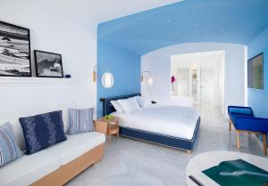 A bed or beds in a room at Mykonos Grand Hotel & Resort
