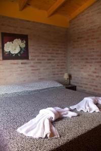 Una cama o camas en una habitación de Koslayna