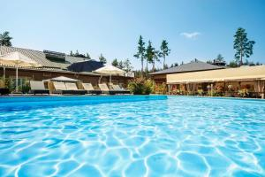 The swimming pool at or near Seasons SPA Boutique Hotel