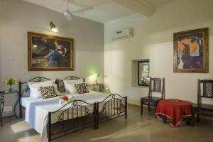 Un ou plusieurs lits dans un hébergement de l'établissement Mandore Guest House