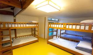 A bunk bed or bunk beds in a room at Moggoji