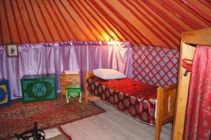 Двухъярусная кровать или двухъярусные кровати в номере Yurt-complex Biy-Khem