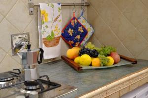 A kitchen or kitchenette at Il Loft di Cinzia&Andrea Family home in HeartOfArt