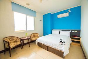 台江大飯店房間的床