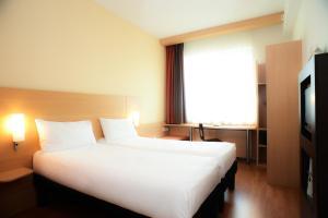 Кровать или кровати в номере Ибис Москва Павелецкая