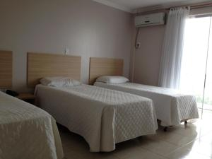 A bed or beds in a room at Hotel Cedro Palace