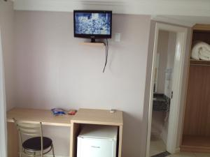 A television and/or entertainment center at Hotel Cedro Palace