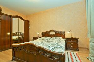 Кровать или кровати в номере Apartment Kanal Griboyedova