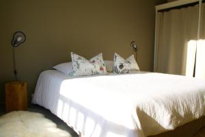 A bed or beds in a room at Appartement Le Clos de Sablier