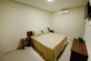 Cama ou camas em um quarto em Wanna Hotel