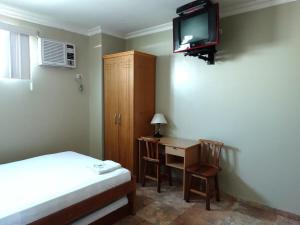 Una televisión o centro de entretenimiento en Hotel Marvento I