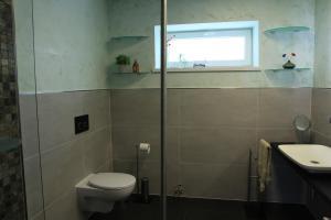 Ein Badezimmer in der Unterkunft greenhouse zentral im grünen