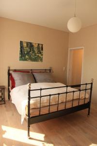 Ein Bett oder Betten in einem Zimmer der Unterkunft greenhouse zentral im grünen