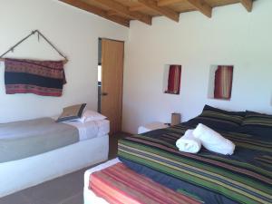 Cama o camas de una habitación en Lodge Altitud