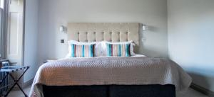 A bed or beds in a room at The Ashton