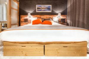 A bed or beds in a room at Hôtel Saint Charles Val Cenis