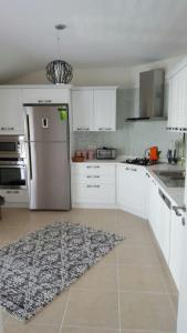 مطبخ أو مطبخ صغير في شقة Tayba