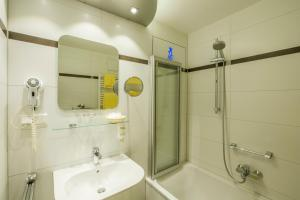 Ein Badezimmer in der Unterkunft Hotel Brunner