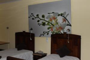 A bed or beds in a room at Hostel Avenida Coimbra