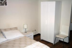 A bed or beds in a room at Le Muse