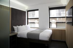 A bed or beds in a room at The Z Hotel City