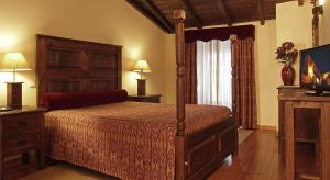 A bed or beds in a room at Hotel Real d Obidos