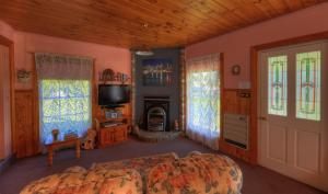A television and/or entertainment center at Rosebank Cottage Collection