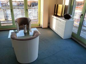 Ein Sitzbereich in der Unterkunft Hotel am Drömling