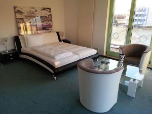 Ein Bett oder Betten in einem Zimmer der Unterkunft Hotel am Drömling