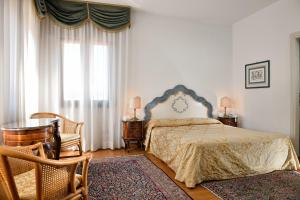 A bed or beds in a room at San Marco Palace