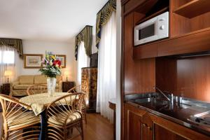 A kitchen or kitchenette at San Marco Palace