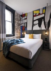 A bed or beds in a room at Ovolo 1888 Darling Harbour