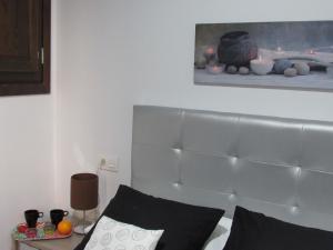 Cama o camas de una habitación en Apartamentos Ilíberis