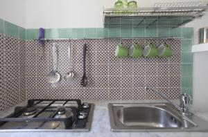 A kitchen or kitchenette at Alghero Ciutat