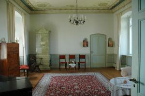 Ein Sitzbereich in der Unterkunft Schloss Herberge Hohenerxleben
