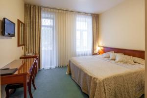 Кровать или кровати в номере Отель Жук Жак