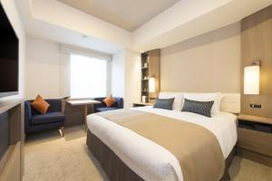 A bed or beds in a room at Tokyu Stay Ginza