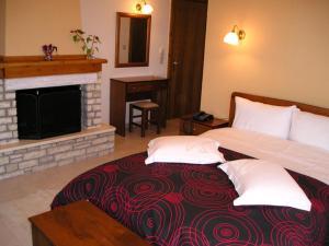 Ένα ή περισσότερα κρεβάτια σε δωμάτιο στο Hotel Ilianna